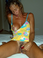 Slim Tanned milf with silicone tits..