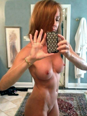 This redhead mature woman apparently..